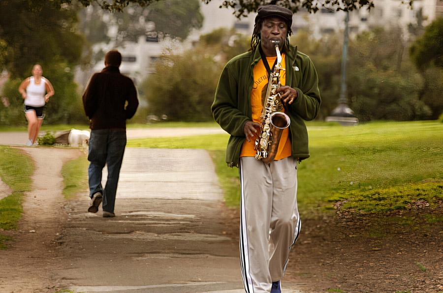 Sax player walking in Oakland